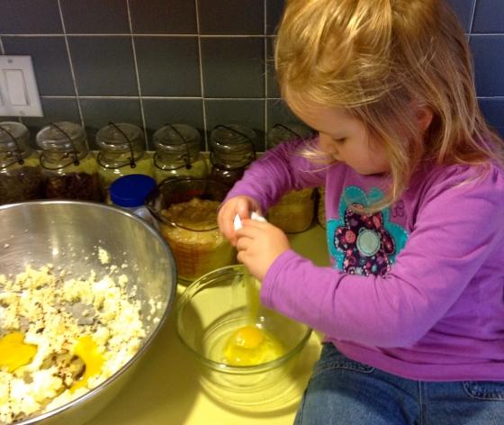 Helping crack eggs